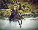 Cowboy Riding Horse In The Water And Splash Water Drops