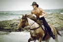 Cowboy Riding Horse On The Beach