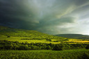 Green hills in mountain valley stormy landscape photo
