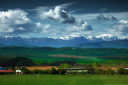 Farm field and mountain with clouds