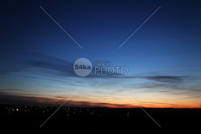 Sunset over the small city winter water village view travel town sunset sunny sundown sun street small sky romantic romance red panorama outdoor old night nature landscape houses house holiday historic evening Colors clouds cloud city building blue beautiful architecture 54ka StockPhoto