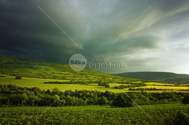 Green hills in mountain valley stormy landscape photo white weather view vibrant valley travel sunrise sunny sunlight sun summer spring sky season scenery scene rural plant Plain pasture paradise outdoor nature natural mountain meadow light lawn landscape land horizon hill grow green grassland grass fresh flower field farm environment day countryside country colorful color cloudy cloudscape cloud clear bright blue beauty beautiful background alpine agriculture 54ka StockPhoto