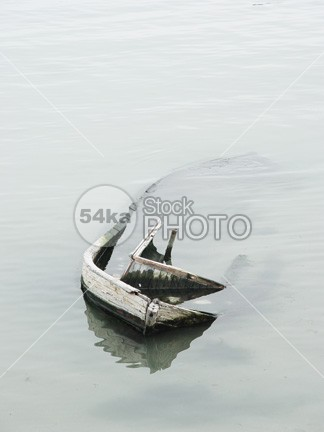 Small fishing boat sank to the coast wooden wood white water warm vessel tropical tide sunken sunk stranded sky serene sea sand Sailing reflection quiet peaceful paradise ocean nautical Morning malawi Fishing drift dream boat blue beach 54ka StockPhoto