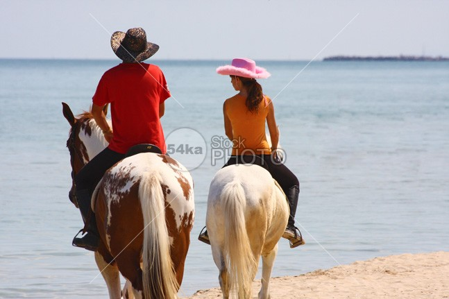 Horse Riding on the Beach young Vacations Two People Two Animals travel sport sky sea saddle Riding Purebred Horse outdoors Men Individual Sports horseback horse holiday Harness Girls cool Coastline riding Coastline blue Beauty In Nature beauty beautiful beach animals animal Activity 54ka StockPhoto