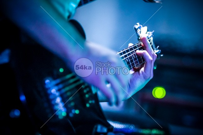 Close-up guitar – blue background young studio Standing sound solo sensual rocker rock playing player person performance musician musical music modern model Men Male light colored instrument Indoors holding high fidelity handsome guy guitarist guitar fun Fashion expression entertainment energy emotion Electric guitar Electric cool concert color chord blue 54ka StockPhoto