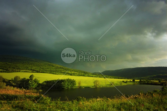Small river and dramatic cloudy sky over the green hills wonder wilderness wild weather water view unique tropical tropic trekking travel sunny summer sky season scenery river plant palm outdoor nobody nature mountain meadow majestic light landscape jungle horizontal hill high green greatness grass freshness forest Extreme exotic environment drc destination crossprocess color clouds blue backgrounds 54ka StockPhoto