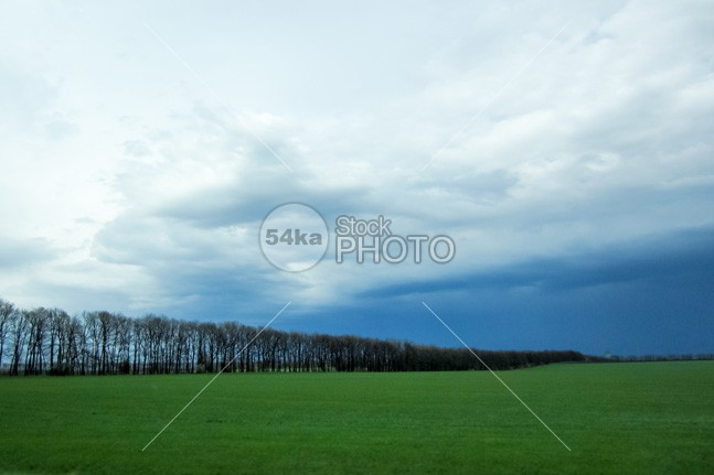 Green field and cloudy blue sky white weather vista trees sunrise sunny sunlight summer lanscape summer spring landscape spring sky season scenery scene rural plant pasture outdoor nobody nature background nature natural meadow light lawn landscape land hill green meadow green grass field green field green grassland grass field grass forest field farmland farming farm field farm environment day countryside cloud blue beautiful background agriculture 54ka StockPhoto