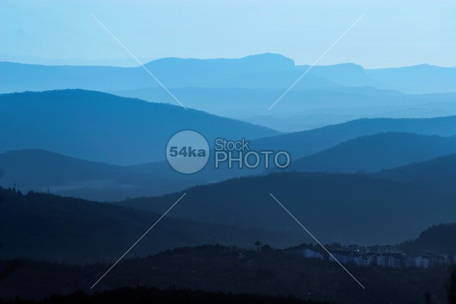 Beautiful mountain landscape in blue view valley urban tree tranquil town tourism sunshine sunset summer spectacular sky serenity scenic scenery scene range planes pine peak panorama outdoor open noon nobody nature mountains mountaineering mountain massif majestic light landscape hill highlands hi view great grassland from the air freedom Fog environment ecology desolate day cloud clean blue ridge blue beautiful background away air 54ka StockPhoto