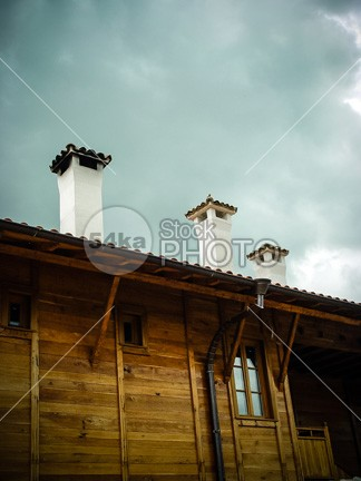 Old House Tiled Roof Top With Chimney yellow white vintage up tube travel traditional townhouse town Top tile texture tall summer structure stone soot Smoke sky rooftop roof retro residential residence red pollution pattern orange old moss material house home historical high greenhouse gases exterior europe estate dirty detail day construction colorful color coal cloudy cloud city chimney building brick blue beautiful background architecture aged 54ka StockPhoto