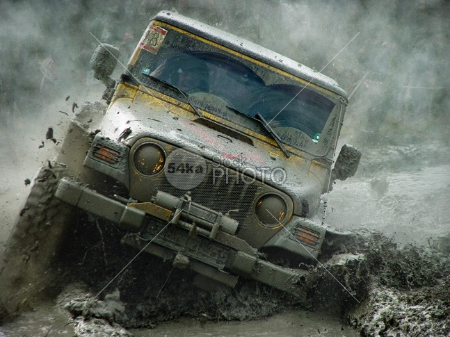 Off Road 4×4 Vehicle Race in Mud winner wild wheel wave water vehicle transportation transport training trail terrain sports sport splash speed skill rover risk rally race outdoor offroad off-road off muddy mud moving motorsport land grip gear fun four fast Extreme driver drive dirty dirt dangerous danger cross country control competition close-up challenge Adventure action 4x4 4-wheel 54ka StockPhoto