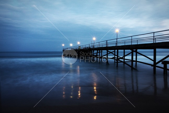 Winter Sea Landscape On The Bridge women winter waves water violet vacation Twilight tropical travel tourism sunset sunrise summer spring sky Silhouette sea sand resort relax reflection reflect pier paradise ocean loneliness landscape footbridge evening dusk dramatic construction coast cloudy cloud bridge blue black beach 54ka StockPhoto