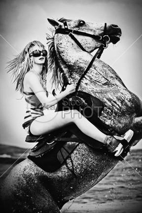 Girl on the white rearing up horse woman white vertical up teenager Standing stallion sport sea saddlebred saddle Riding ride rearing rear purebred pretty power pets Perfection outdoors neck nature Motion model mare mane mammal image horses horseback horse high head grace girl forest Fashion equestrian elegance dressage dangerous danger bridle breed black and white beauty beautiful arabian animal action 54ka StockPhoto