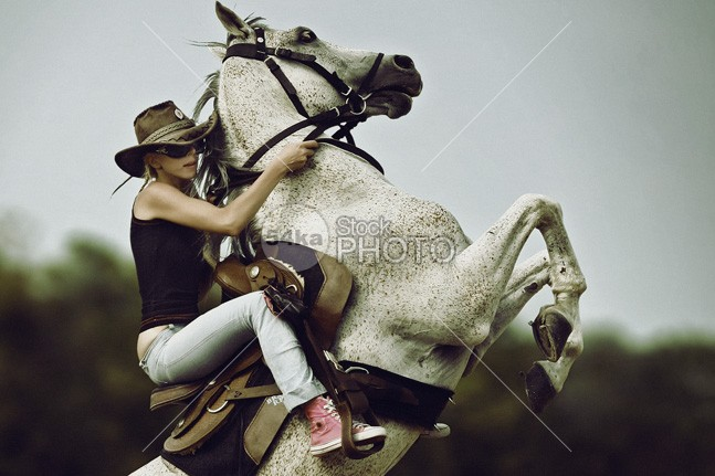 Girl riding horse on the two rear legs young woman white vogue two legs trunk stand stallion sexy sensuality sensual Riding ride rearup reared rear up rear Posing portrait person movement model mare lovely legs lady horseback horse Glamour girl female Fashion expression equine equestrian emotion dynamic dress bride blonde beauty beautiful animal 54ka StockPhoto