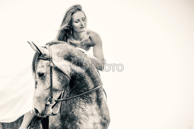 Beautiful woman in white dress and black horse portrait photo People outdoors nature natural movement move model marriage mare makeup lovely looking look long light legs lady isolated horseback horse gorgeous Glamour girl gelding Friendship friend female Fashion farmstead face expression equine photography equine equestrian beauty equestrian emotion dynamic dress day circus Caucasian bride blonde beauty and the beast beauty beautiful attractive Art animal adult Activity 54ka StockPhoto