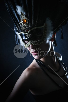 Beauty model wearing venetian masquerade carnival mask party new Mystery mysterious model masquerade mask makeup make light lady isolated holiday head Glamour girl female Fashion fantasy face eye mask eye event elegance earrings disguise Decoration dark curly conceal club close celebration celebrating celebrate Caucasian carnival brunette bokeh black beautyful beauty beautiful ball Art amber eyes amber eye amber adult accessories 54ka StockPhoto